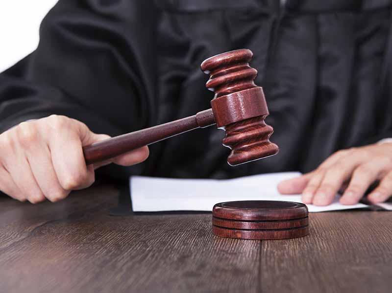judge hitting gavel at disability hearing
