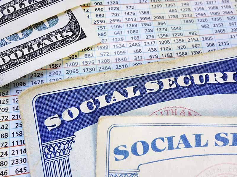 social security cards with insurance docs, close up photo