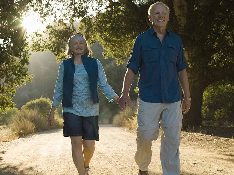elderly couple walking on path through a Quarterman Park