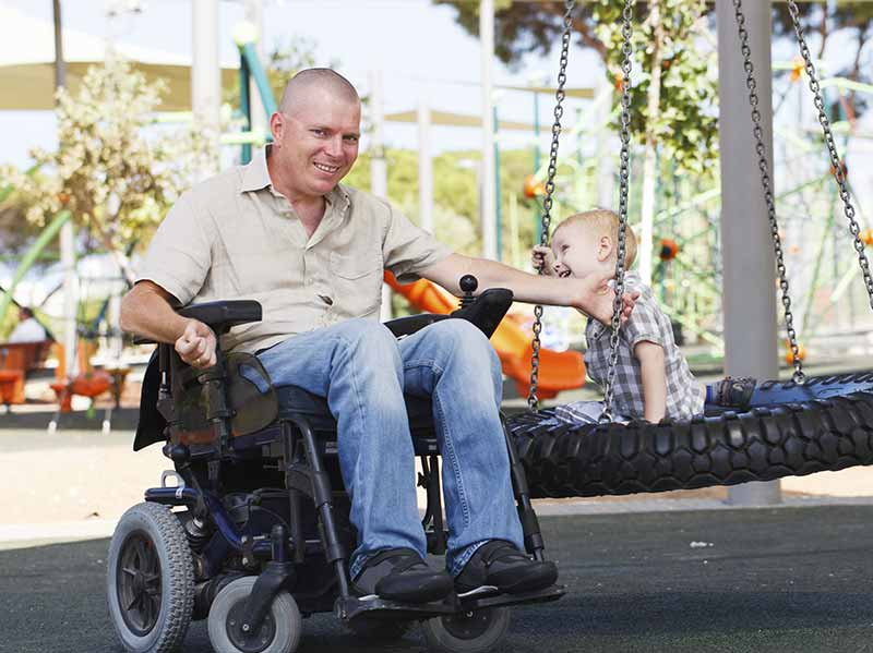 Disabled veteran in wheelchair with child