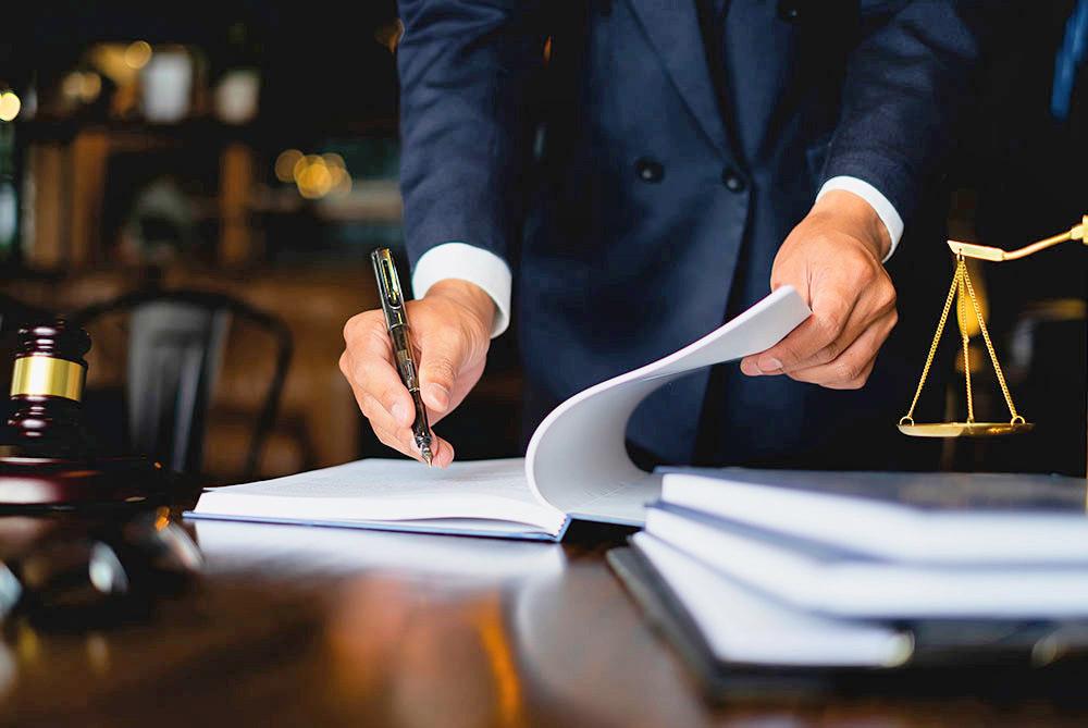ssdi attorney signing paperwork