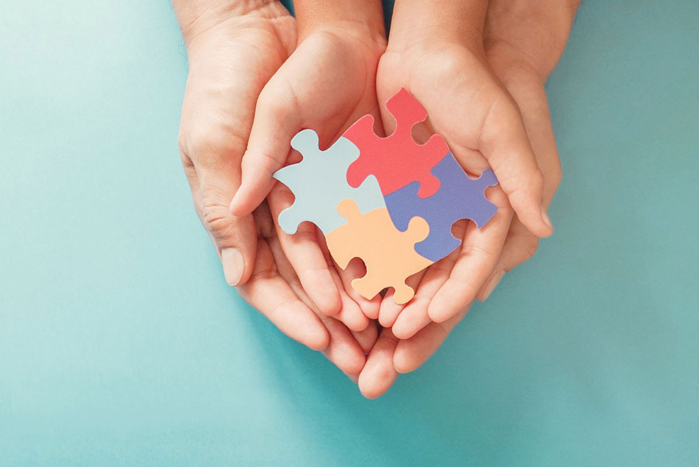 ssdi benefits for disabled children puzzle pieces in hand