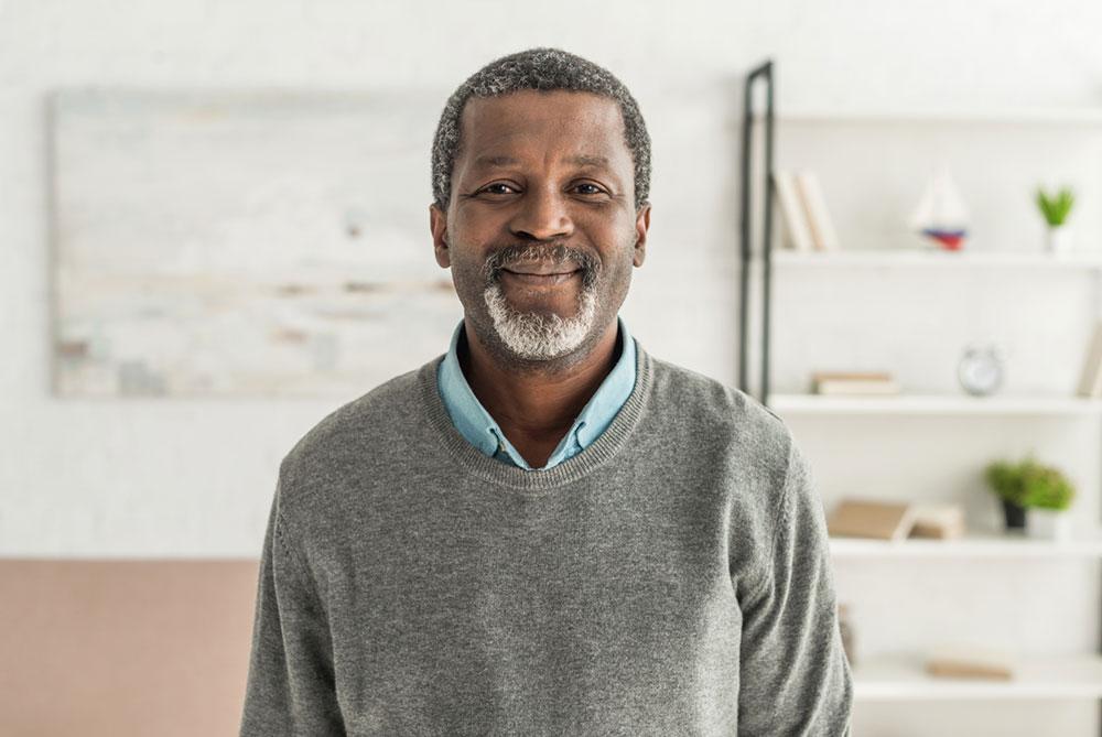 older man smiling after winning ssd appeal case